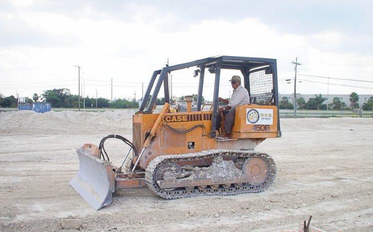 Man using an earth leveler machine