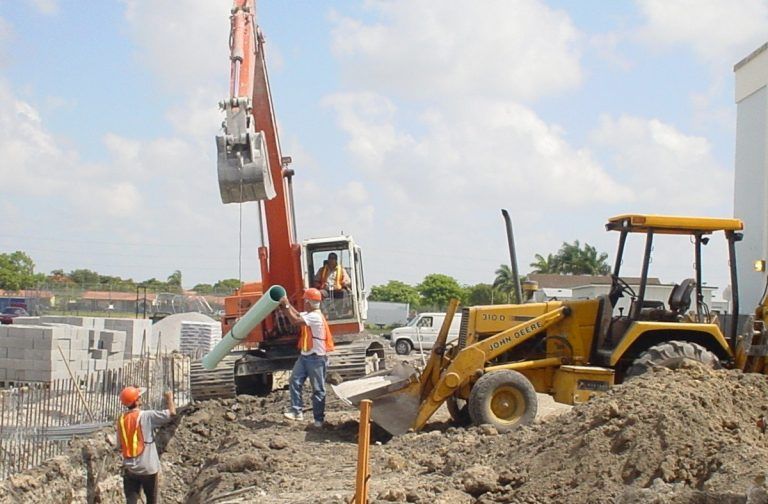 Workers working on a sewer system