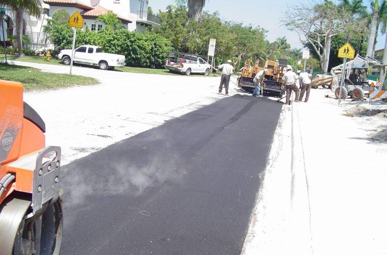 Men working on building an asphalt road